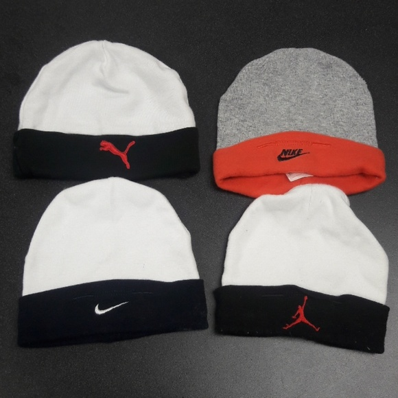 11a750a9fc3 ... authentic set of 4 nike jordan puma baby boy hats a8a84 9f4d4 ...